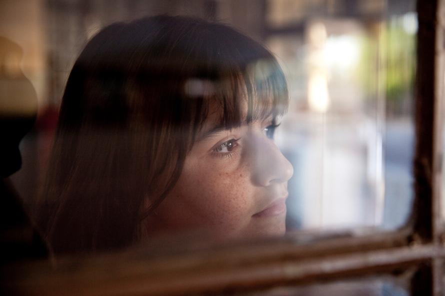 RARA Sara looks through the window
